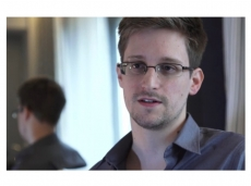 US Government official sues journalists over Snowden
